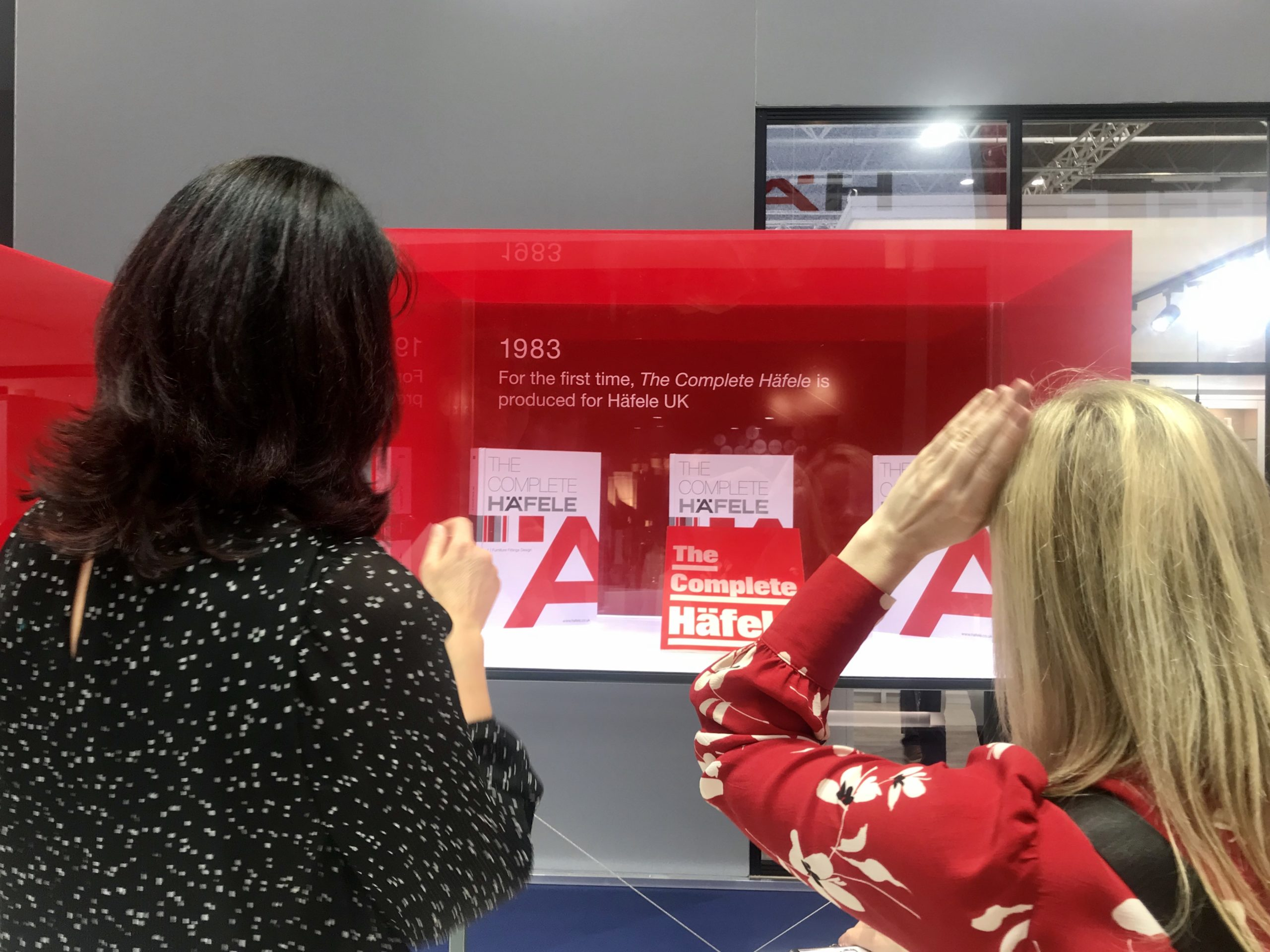 The editor of kbbreview checks out the Häfele timeline at kbb2020 - media relations and press office activity at exhibitions